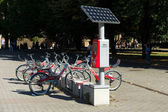 Bicycle rental company Deutsche Bahn (German Railways), autonomous (solar panels) work machine to pay rent — Stock Photo
