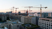 Sunrise over Berlin. Construction of new buildings in the city center — Stock Photo