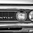 Постер, плакат: Headlamp car Pontiac Firebird 1968 black and white