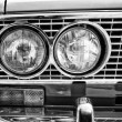 Stock Photo: Headlamp soviet family car VAZ-2106, close-up, black and white