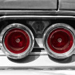 Постер, плакат: The rear brake light midsize car Dodge Charger RT black and white