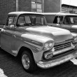 Detail of the full-size pickup truck Chevrolet Apache (1958), black and white — Стоковая фотография