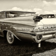 Stock Photo: Full-size car Oldsmobile 98 (Fifth generation), rear view, sepia