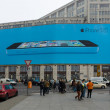 At Potsdamer Platz, on the wall is a giant billboard flagship phone of Apple - iPhone 5C — Stock Photo