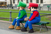 Animators in costume Super Mario Bros. near the Brandenburg Gate — Stock Photo