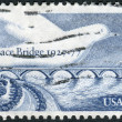 A postage stamp printed in the USA, dedicated to the 50th anniversary of the Peace Bridge, connecting, Buffalo, NY with Fort Erie, Ontario, shows the Peace Bridge and Dove — Photo