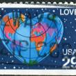 Postage stamps printed in USA, shows the Earth in the form of heart and a map of the world — Stock Photo