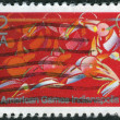A postage stamp printed in the USA, dedicated to the Pan American Games, Indianapolis, shows Runner in Full Stride — Stock Photo