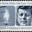 Stock Photo: Postage stamp printed in the USA, a portrait of 35th President of the United States, John Fitzgerald Kennedy and Eternal Flame