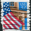 Postage stamps printed in USA, shows the USA national flag over Porch — Stock Photo