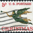 Stock Photo: Postage stamps printed in USA, Christmas Issue, shows weathervane in form of Archangel Gabriel with Trumpet