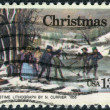 "A postage stamp printed in USA, Christmas Issue, shows picture ""Winter Pastime"" by Nathaniel Currie — Stock Photo"