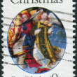 "Stock Photo: Postage stamp printed in USA, Christmas Issue, shows detail from painting by Master of St. Lucy Legend. Angel from ""Mary, Queen of Heaven"""