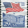 A postage stamp printed in USA, shows the USA national flag over White House, Washington — Stock Photo