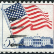 A postage stamp printed in USA, shows the USA national flag over White House, Washington — Stock Photo #36494845
