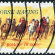 "Postage stamp printed in the USA, dedicated to the 100th anniversary of racing on horseback ""Kentucky Derby"" shows Horses Rounding Turn — Stock Photo #36495733"