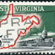 A postage stamp printed in the USA, is dedicated to West Virginia Statehood Centenary, shows Map of West Virginia and State Capitol — Stock Photo