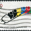 A postage stamp printed in the USA, dedicated to the 11th Winter Olympic Games, Sapporo, Japan, shows Bobsledding — Stock Photo #36496143