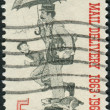 A postage stamp printed in the USA, dedicated to the Free City Mail Delivery Centenary, shows Letter Carrier — ストック写真