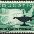 Postage stamps printed in USA, Higher Education Issue, shows Map of US and Lamp — Stock Photo #36496453