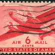 Postage stamps printed in USA, shows Twin-Motored Transport Plane — Stock Photo