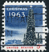 A postage stamp printed in USA, Christmas Issue, shows National Christmas Tree and the White House — Stock Photo