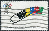 A postage stamp printed in the USA, dedicated to the 11th Winter Olympic Games, Sapporo, Japan, shows Bobsledding — Stock Photo