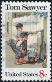 A postage stamp printed in USA, American Folklore Issue, shows Tom Sawyer, by Norman Rockwell — Stock Photo