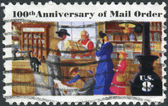 A postage stamp printed in the USA, centenary of mail order business, originated by Aaron Montgomery Ward, Chicago, shows a Rural Post Office Store — Stock Photo