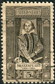 Postage stamp printed in the USA, dedicated to the 400th anniversary of the birth of William Shakespeare, shows writer, playwright and poet William Shakespeare — Stock Photo
