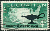 Postage stamps printed in USA, Higher Education Issue, shows Map of US and Lamp — Stock Photo