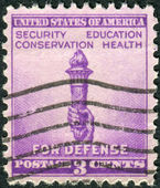 Postage stamp printed in the USA, National Defense Issue, shows Torch of Enlightenment — Stock Photo