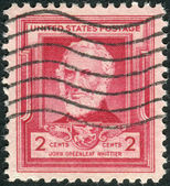 Postage stamps printed in USA, shows a portrait of an influential American Quaker poet John Greenleaf Whittier — Stock Photo