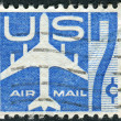 A postage stamp printed in USA, shows the silhouette of a jet airplane — Stock Photo