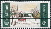 A postage stamp printed in USA (overprint ATLANTA, GA), Christmas Issue, shows Winter Sunday in Norway, Maine — Stock Photo