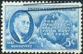 Postage stamp printed in the USA, shows a portrait of 32th President of the United States, Franklin Delano Roosevelt, Globe and Four Freedoms — Stock Photo