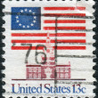 Postage stamp printed in the USA, shows 13-Star Flag, Independence Hall, Philadelphia — Stock Photo