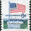 Postage stamp printed in the USA, shows the national flag and White House — Stock Photo