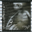 Postage stamp printed in the USA, American Filmmaking: Behind the Scenes, Special effects (Mark Siegel working on model for E.T. The Extra-Terrestrial) — Stock Photo