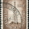 Stock Photo: Postage stamp printed in USA, dedicated to Centenary of completion of nation's 1st oil well at Titusville, Pa., shows Oil Derrick