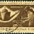 Postage stamp printed in the USA, dedicated to the American Bicentennial, Colonial American Craftsmen, shows a Silversmith — Stock Photo #37239383