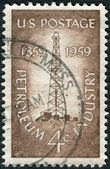 Postage stamp printed in the USA, dedicated to the Centenary of the completion of the nation's 1st oil well at Titusville, Pa., shows a Oil Derrick — Stock Photo