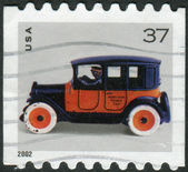 Postage stamp printed in the USA, shows a Toy Taxicab — Stock Photo