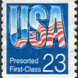 Postage stamp printed in the USA, shows the the USA national flag — Stock Photo