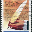 Postage stamp printed in the USA, dedicated to the 200th anniversary of the signing of the U.S. Constitution, shows hand, quill pen and the text of the Constitution — Stock Photo