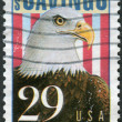 Stock Photo: Postage stamp printed in USA, dedicated to 50th Anniversary Savings Bonds, shows Bald Eagle (Haliaeetus leucocephalus)