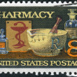 Postage stamp printed in the USA, dedicated to the 120th anniversary Pharmaceutical Association, shows Mortar and Pestle, Bowl of Hygeia, 19th Century Medicine Bottles — Stock Photo #37458409