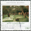 "Stock Photo: Postage stamp printed by Germany, shows picture of ""Bleaching Ground"", German-Jewish painter and printmaker, Max Liebermann"