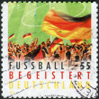 Postage stamp printed by Germany, dedicated to the 2012 UEFA European Championship, shows German football fans — Stock Photo #37459079