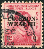 Postage stamp printed in the Philippines (overprint dedicated 1st anniviversary of the Commonwealth), shows a portrait of a Filipino nationalist, writer and revolutionary Jose Rizal — Stock Photo